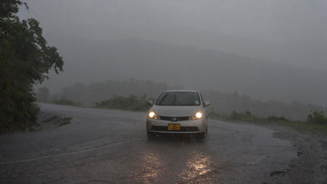 A vehicle in the rain in Mozambique at the beginning of Tropical cyclone Idai on March 15, 2019. (AFP)