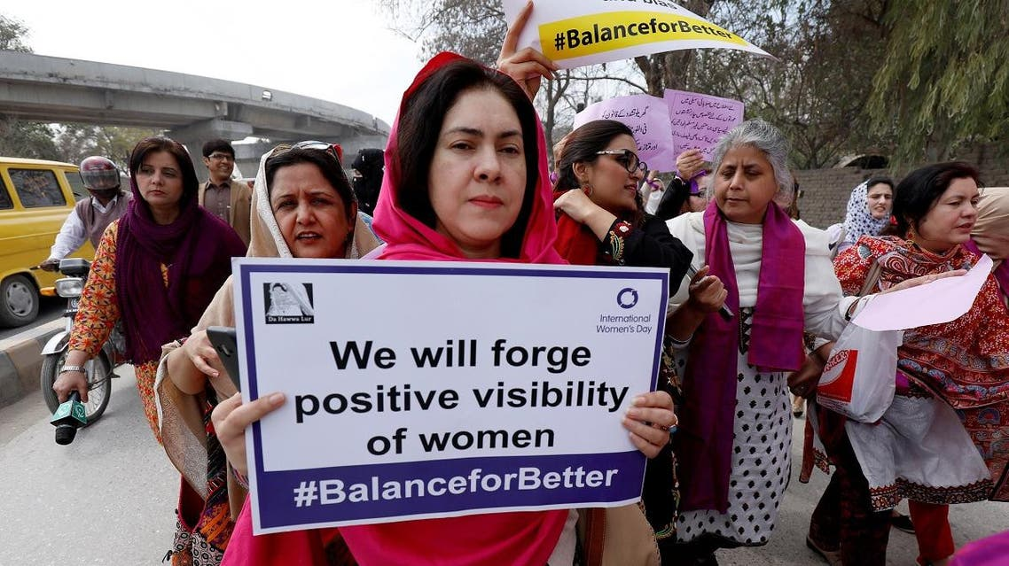 A participant carries a sign during a rally to mark International Women's Day in Peshawar, Pakistan March 8, 2019. (Reuters)