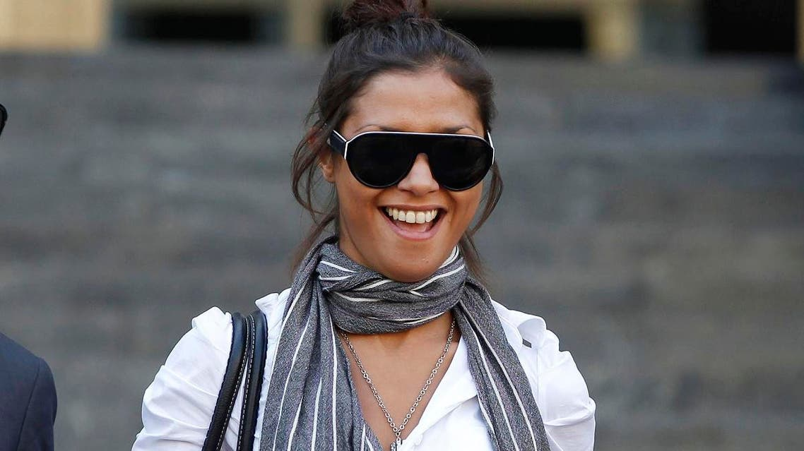 File photo of  Imane Fadil smiles as she leaves the court in Milan, Italy.  (AP)