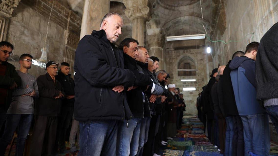 Palestinian Muslims pray inside the Golden Gate near Al-Aqsa mosque in Jerusalem's Old City. (Reuters)