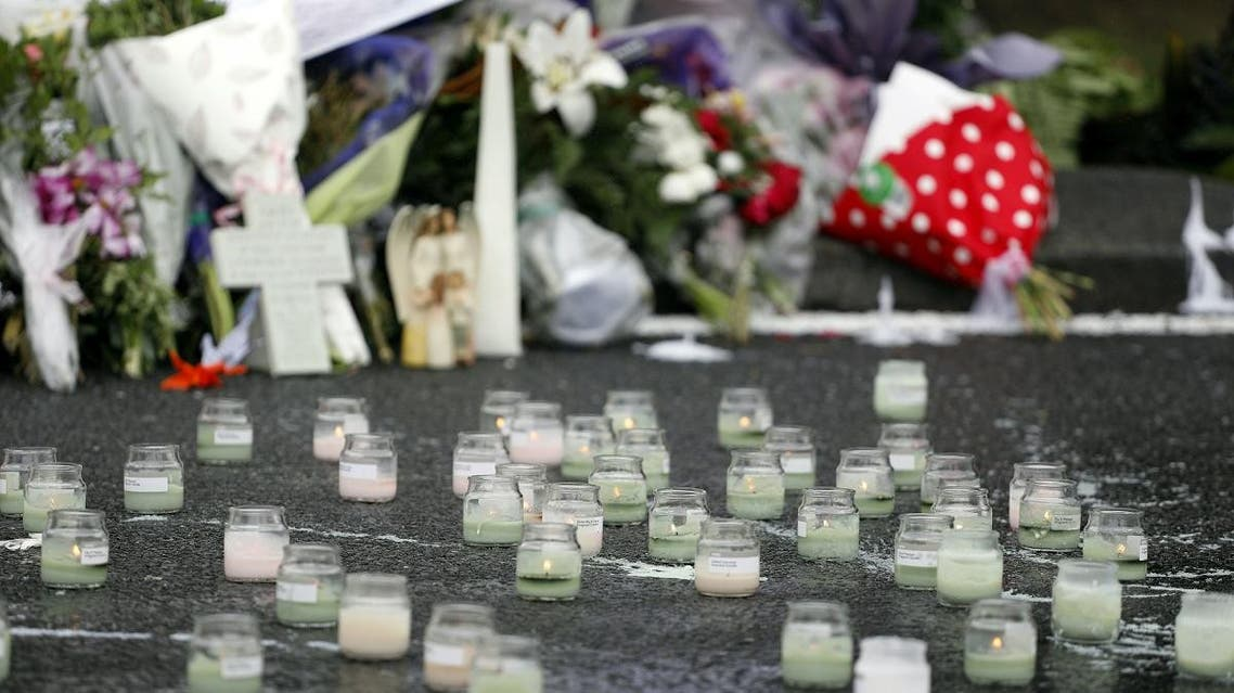 Lit candles are seen in front of floral tributes at a makeshift memorial for victims of the March 15 mosque attacks, in Christchurch on March 17, 2019. (AFP)