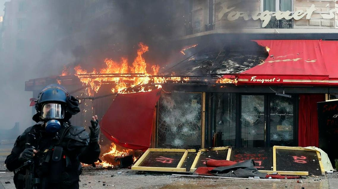 Paris famed restaurant Fouquet's burns on the Champs Elysees avenue during a yellow vests demonstration Saturday, March 16, 2019 in Paris. (AFP)