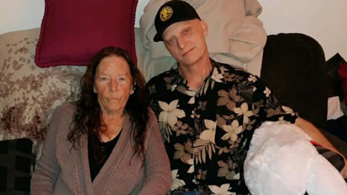 Michael White of California poses with his mother Joanne in an undated family photo. He is facing 10 years in prison in Iran. (Reuters)