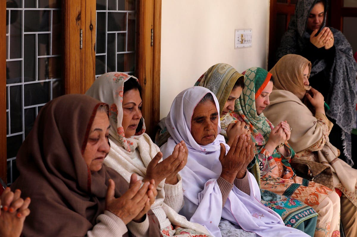 Relatives and family members of Naeem Rashid and Talha Naeem pray during a condolence gathering at the family's home in Abbottabad. (Reuters)