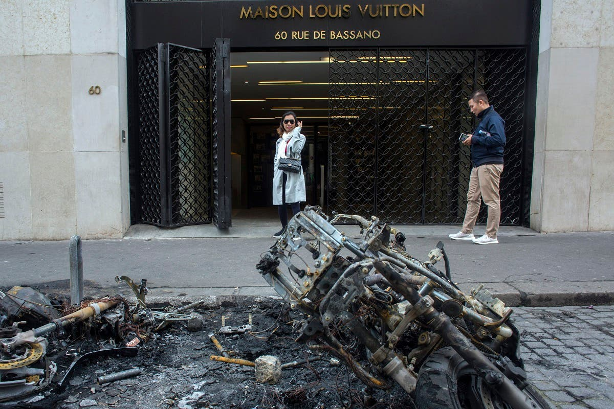 Burned stores on the Champs Elysees avenue during a yellow vests demonstration Saturday, March 16, 2019 in Paris. (AFP)