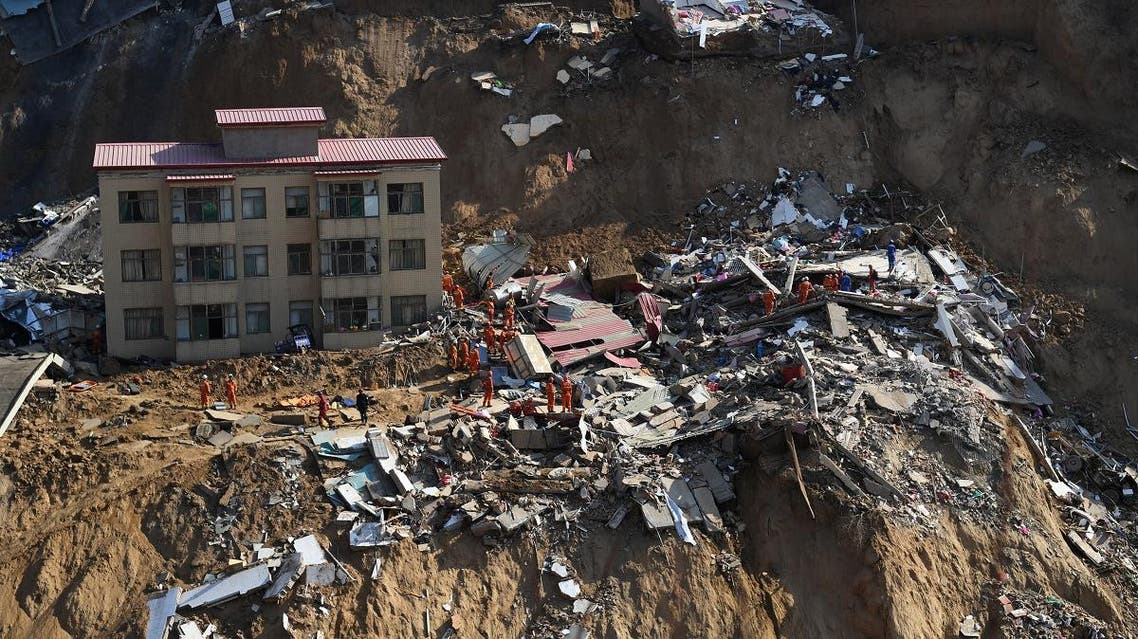 Rescue workers are seen at the debris of collapsed houses following a landslide in Xiangning county, Linfen, Shanxi province. (Reuters)