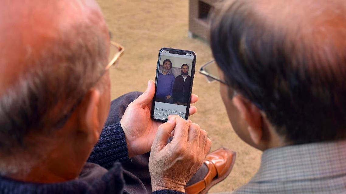 Relatives look the pictures of Pakistani citizen Naeem Rashid, and his son Talha Naeem, who were reportedly killed in the Christchurch mosque shooting. (AP)