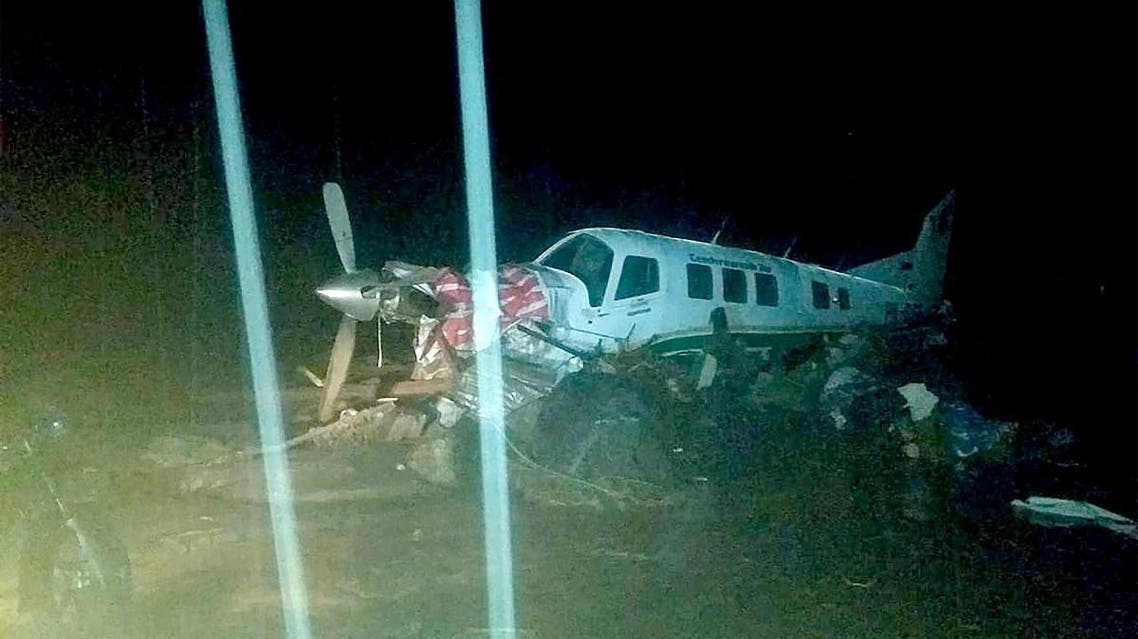 This handout picture taken and released by Indonesia's accident mitigation agency on March 17, 2019 shows a small plane on an airstrip surrounded by floodwaters in Sentani, triggered by torrential rain. (AFP)
