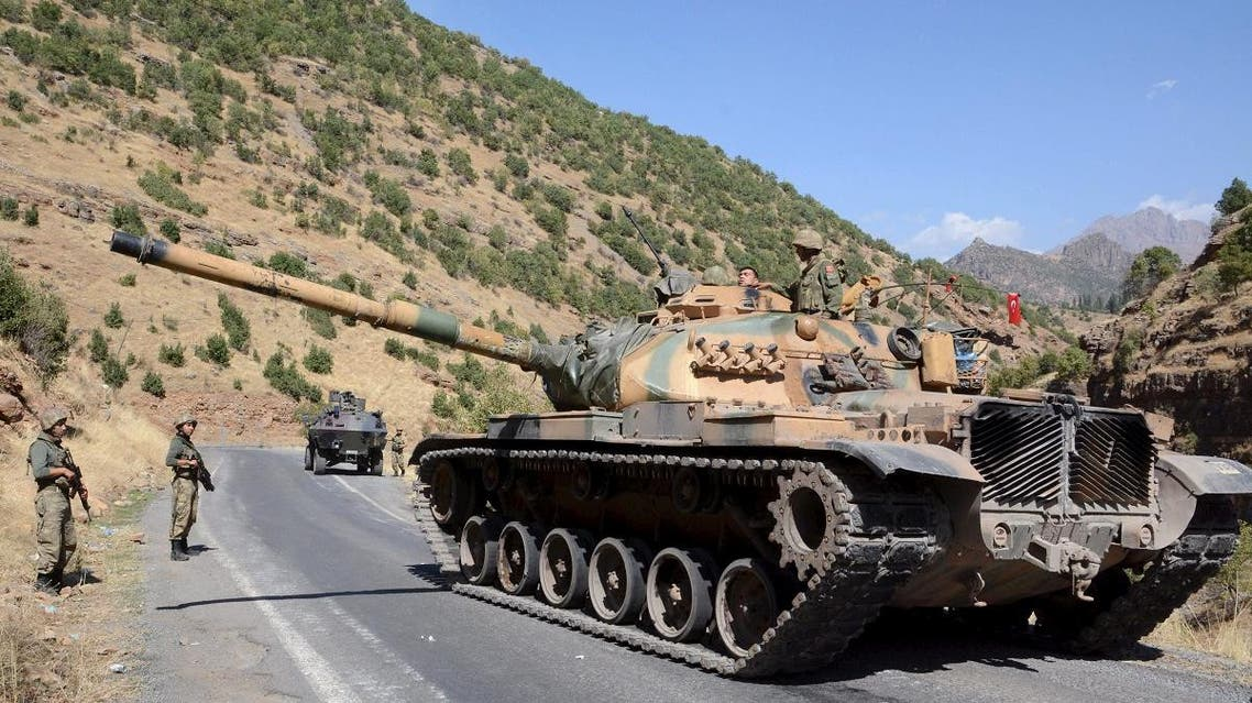 Turkish soldiers in a tank and an armored vehicle patrol on the road to the town of Beytussebab in the southeastern Sirnak province, Turkey. (File photo: Reuters)