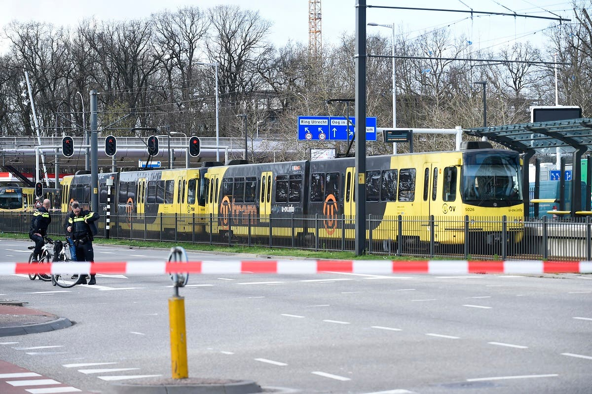 Policemen are at work on March 18, 2019 in Utrecht, near a tram where a gunman opened fire, killing at least three persons and wounding several in what officials said was a possible terrorist incident.