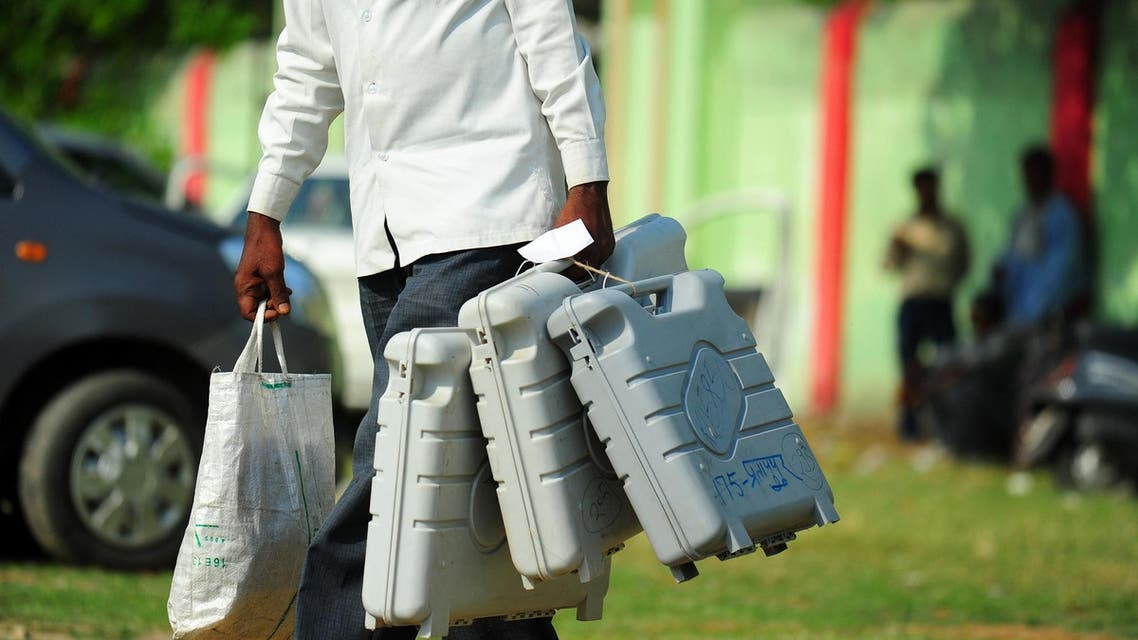 An Indian polling official carries election materials as he leaves a distribution center in Allahabad. (File photo: AFP)