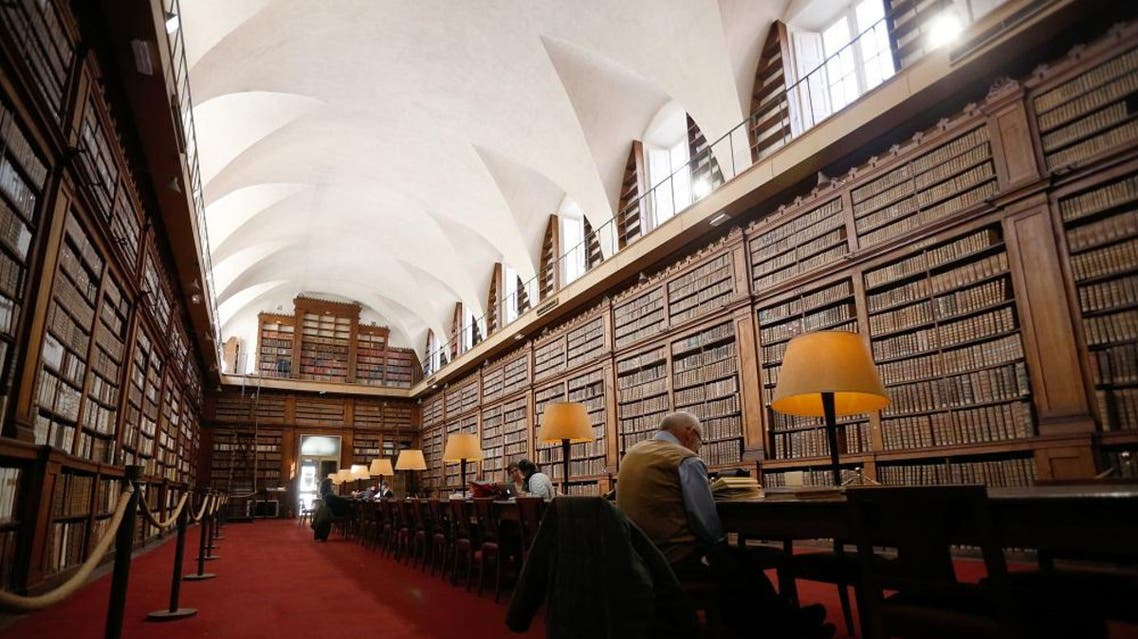 People read books in the Fesch municipal library. (File photo: AFP)