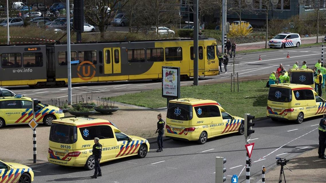 Ambulances are parked next to a tram after a shooting incident in Utrecht, Netherlands, Monday, March 18, 2019. (AP)