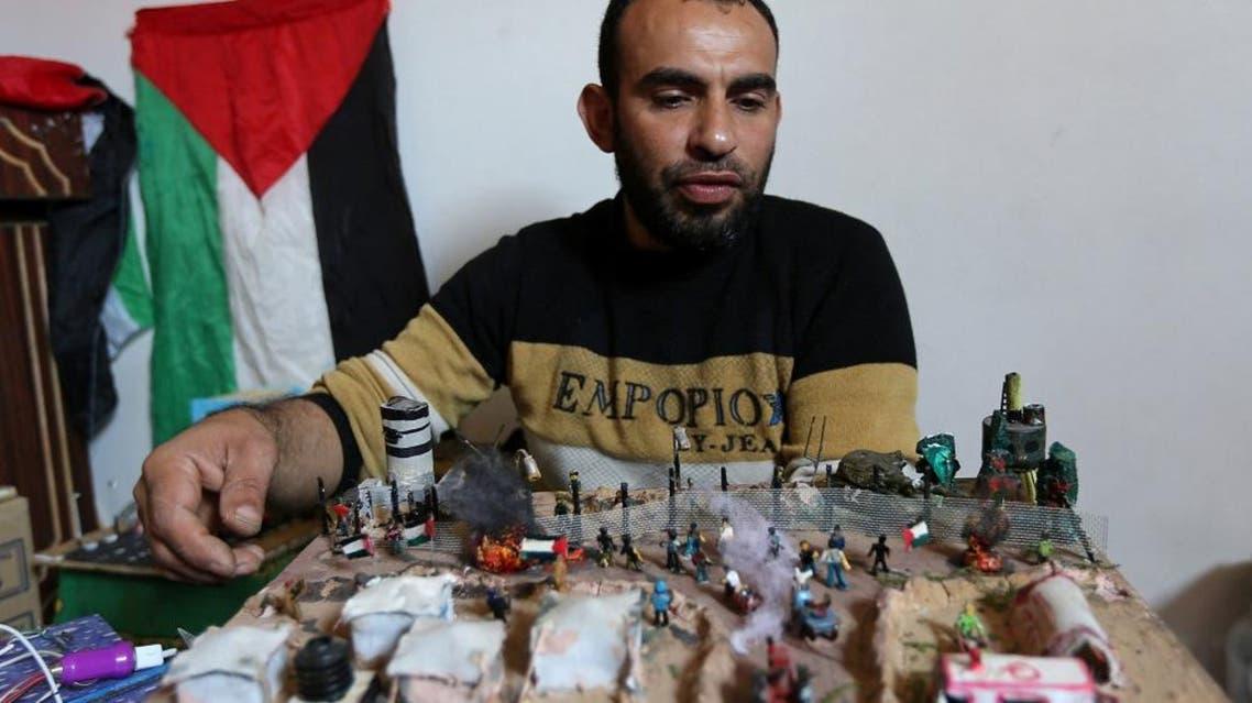 Palestinian Majdi Abu Taqeya makes art pieces of spent Israeli ammunition. (Reuters)