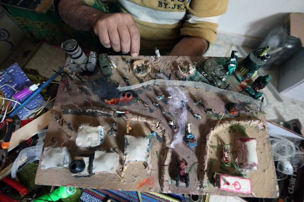 Palestinian Majdi Abu Taqeya makes art pieces of spent Israeli ammunition. (Reuters)