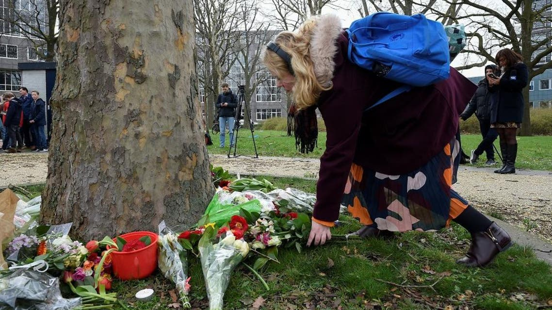 A women lay flowers at the site of a shooting in a tram, at 24 October square in Utrecht. (AFP)