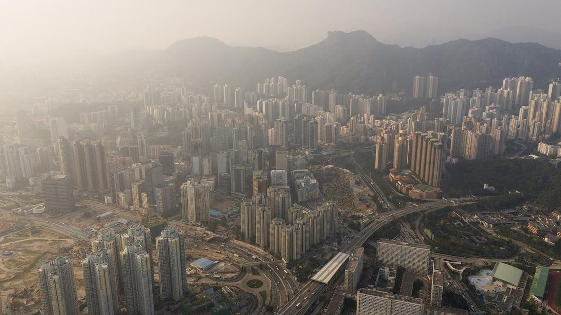 This aerial photo taken on November 23, 2018 shows residential estates in front of Lion Rock (top C) on a polluted day in Hong Kong. Dale DE LA REY / AFP