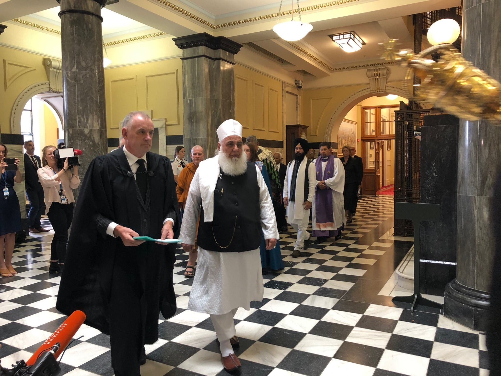 New Zealand Speaker of the House of Representatives Trevor Mallard walks with Imam Imam Nizam ul haq Thanvi