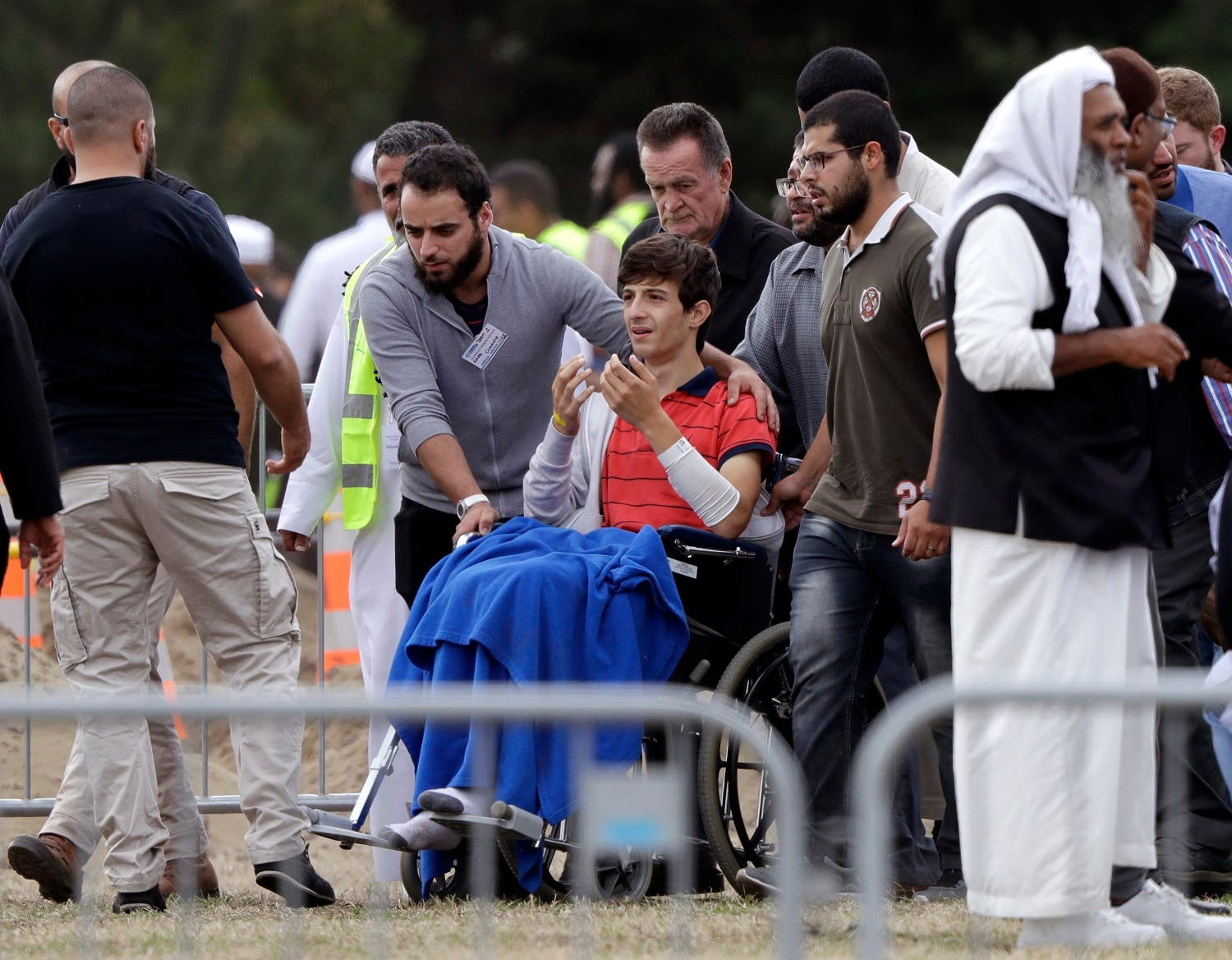 Zaed Mustafa, in wheelchair, during the burial at the Memorial Park Cemetery in Christchurch on March 20, 2019. (AP)