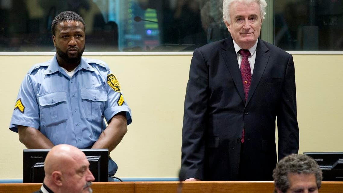 Former Bosnian Serb leader Radovan Karadzic enters the court room of the International Residual Mechanism for Criminal Tribunals in The Hague, Netherlands, on March 20, 2019. (AP)