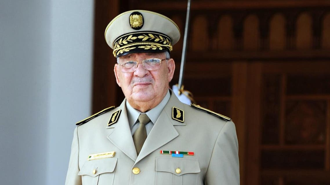 Algeria's Chief of Staff General Ahmed Gaid Salah is seen for the arrival of French Defence Minister Jean-Yves Le Drian at the Houari-Boumediene International Airport in Algiers, on May 20, 2014. (AFP)