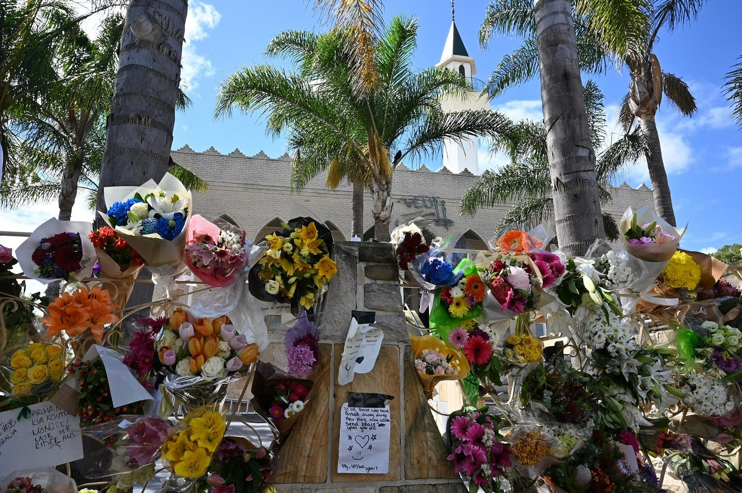 Flowers and messages placed outside Lakemba Mosque in Sydney on March 20, 2018, five days after the mass shooting attacks at two mosques in Christchurch that killed 50 Muslim worshippers in the city. (AFP)