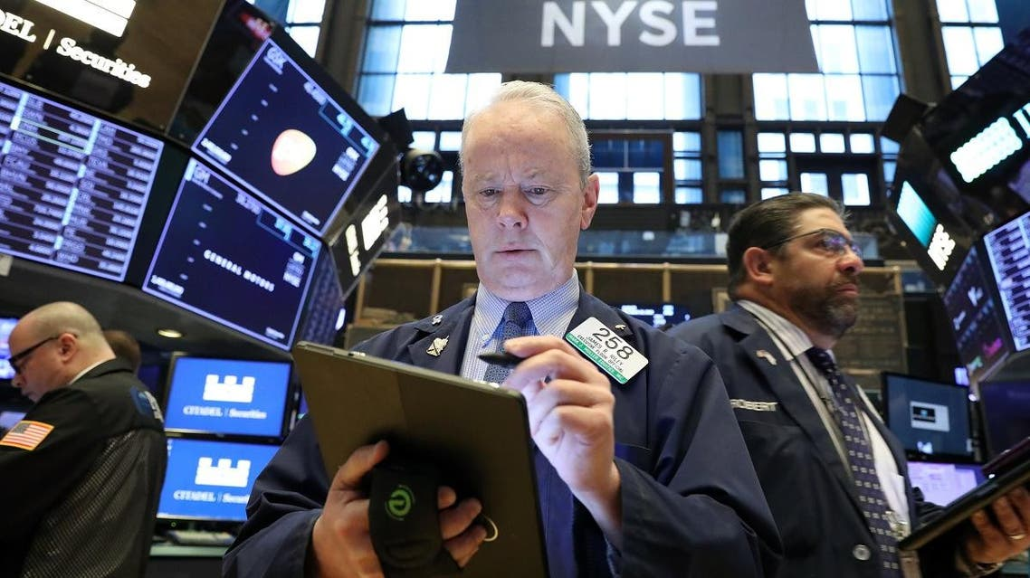 Traders work on the floor at the New York Stock Exchange (NYSE) in New York. (Reuters)