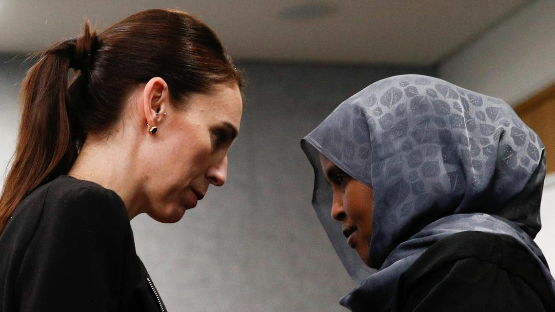 Jacinda Ardern with one of the first responders at the scene of the Christchurch mosque shooting, in Christchurch, on March 20, 2019. (Reuters)