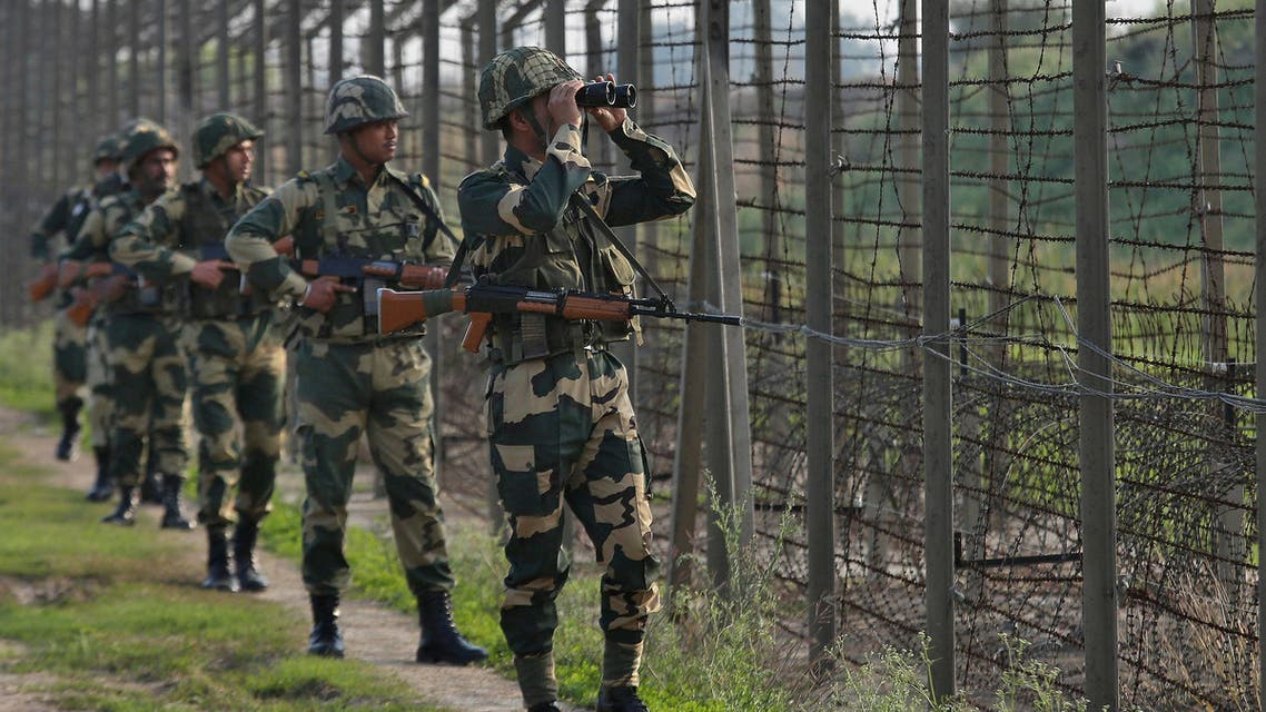 India's Border Security Force soldiers patrol along the fenced border with Pakistan in the Ranbir Singh Pura sector near Jammu on February 26, 2019. (Reuters)