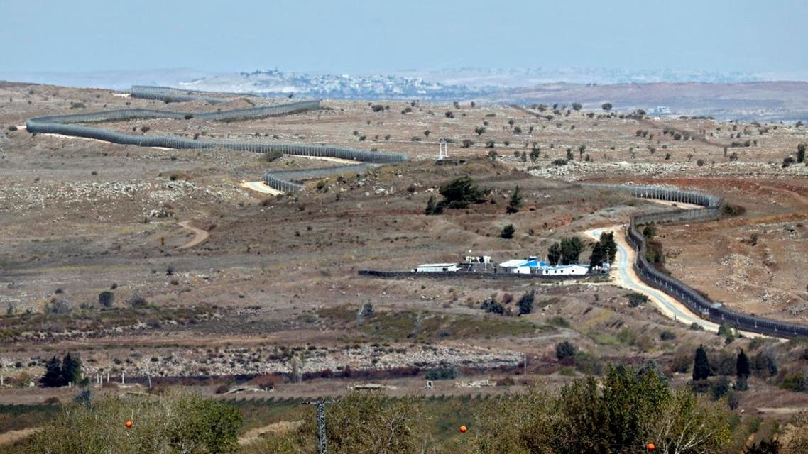 A file photo taken on October 06, 2017 shows the Israeli defensive fence as it snakes, separating the Israeli-occupied sector of the Golan Heights (L) from Syria near Quneitra. Israeli Prime Minister Benjamin Netanyahu on March 21, 2019. (AFP)