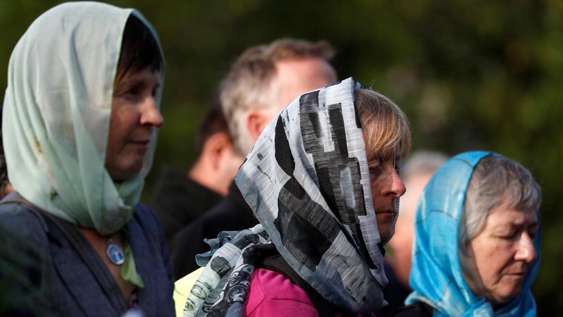 Women wearing head scarfs attend a vigil for the victims of the mosque attacks. (Reuters)