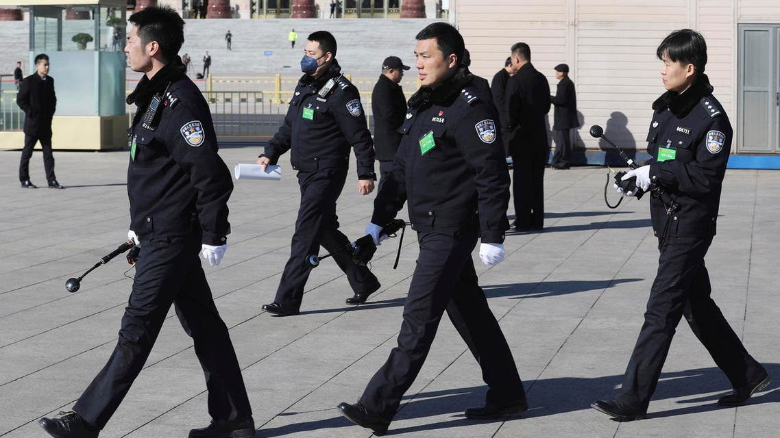 Chinese police officers march past on Tiananmen Square in Beijing. (File photo: AP)