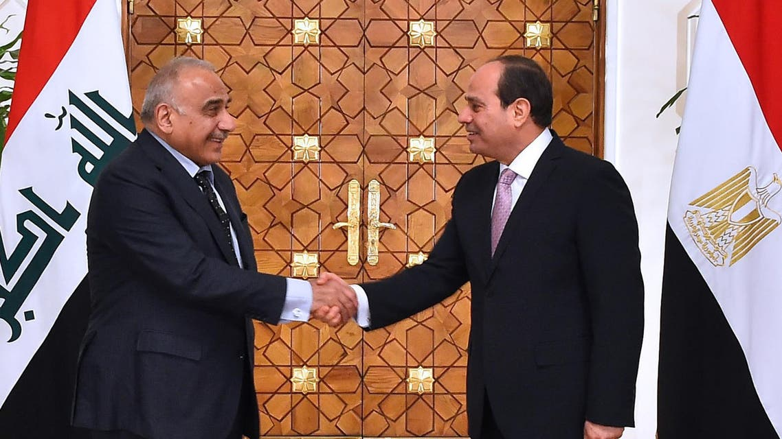 Egyptian President Abdel Fattah al-Sisi shakes hands with Iraqi Prime Minister Adel Abdel Mahdi as he receives the latter at the presidential palace in the capital Cairo on March 23, 2019. (AFP/Egyptian Presidency)