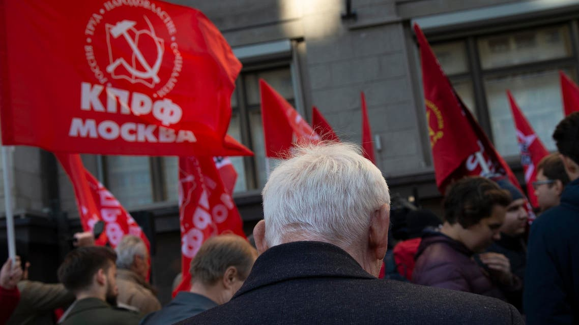 Communist party supporters hold red flags during a protest against the government's plans to raise the retirement age, in front of the Russian State Duma, the Lower House of the Russian Parliament in Moscow, Russia, Wednesday, Sept. 26, 2018 (AP)