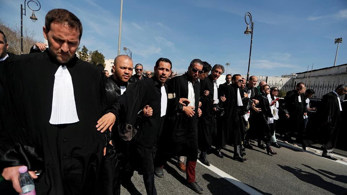 Algerian Lawyers march during a protest to denounce an offer by President Abdelaziz Bouteflika. (Reuters)