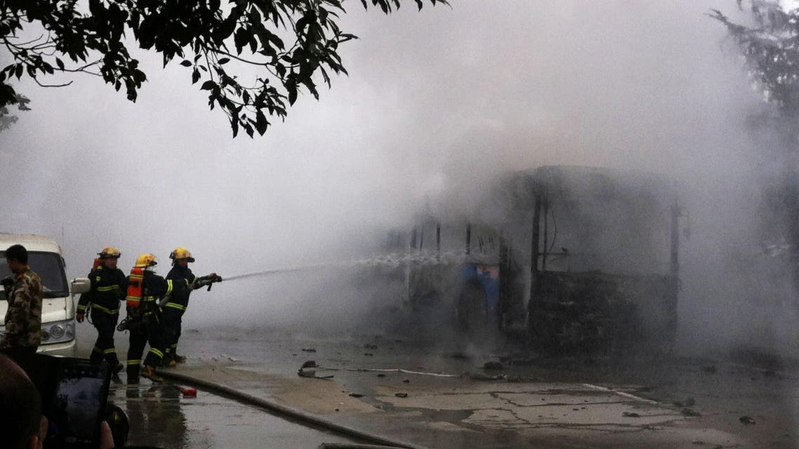 Chinese firefighters douse a public bus which caught fire, killing five people and injuring 32 in the southwestern Chinese city of Guizhou province on February 27, 2014.