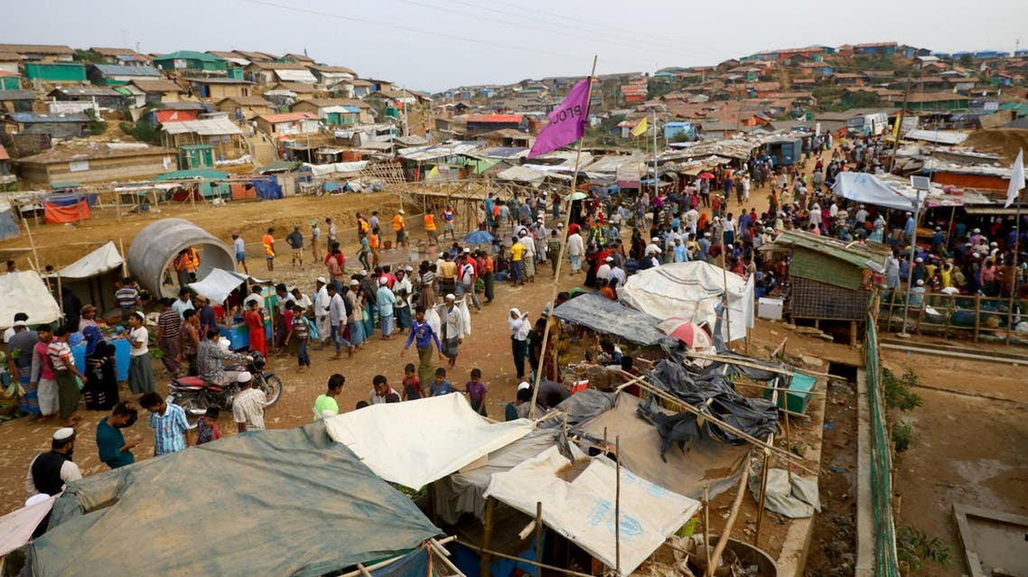 Rohingya refugees gather at a market inside a refugee camp in Cox's Bazar, Bangladesh on March 7, 2019. (Reuters)