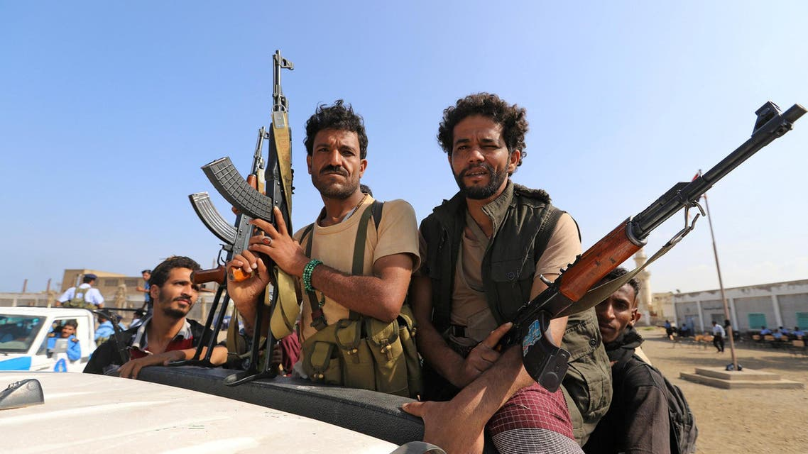 FILE PHOTO: Houthi militants ride on the back of a truck as they withdraw, as part of a U.N.-sponsored peace agreement signed in Sweden earlier this month, from the Red Sea city of Hodeidah, Yemen December 29, 2018. REUTERS/Abduljabbar Zeyad/File Photo