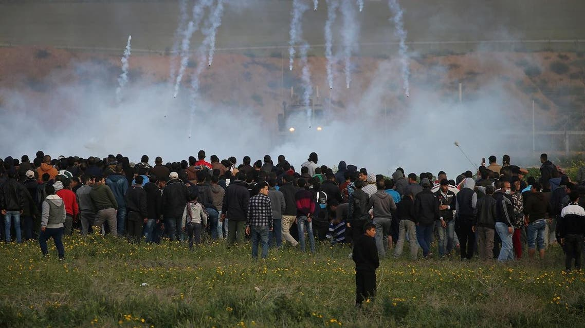 Tear gas canisters are fired by Israeli troops toward Palestinians during a protest at the Israel-Gaza border fence. (File photo: Reuters)