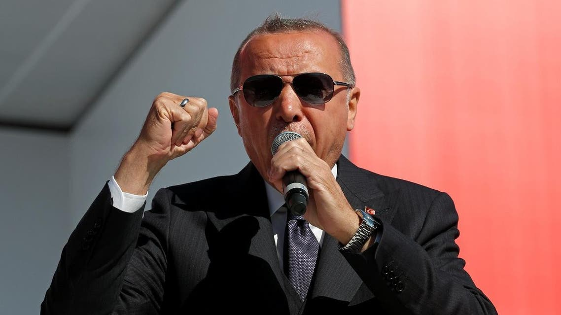 Turkish President Tayyip Erdogan gestures as he addresses AK Party and Nationalist Movement Party (MHP) supporters during a rally for the upcoming local elections, in Istanbul, Turkey March 24, 2019. (Reuters)