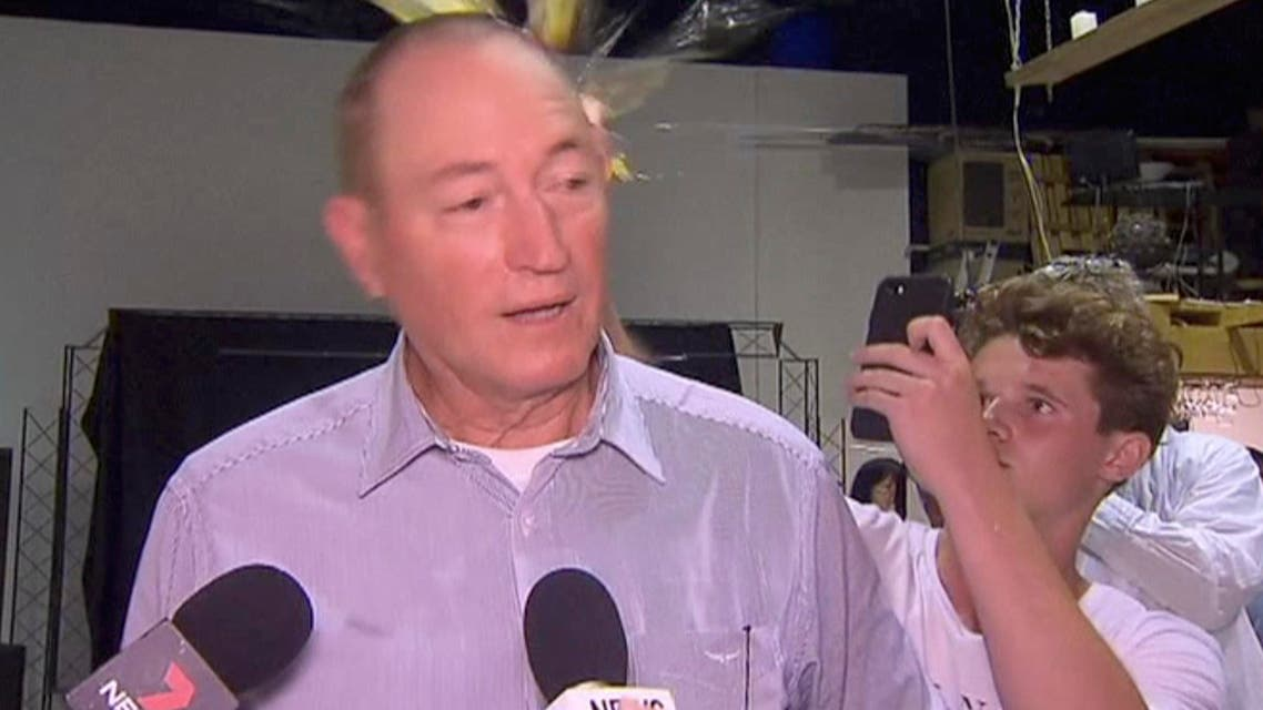 Will Connolly breaks an egg on the head of Senator Fraser Anning on March 16, 2019. (AP)