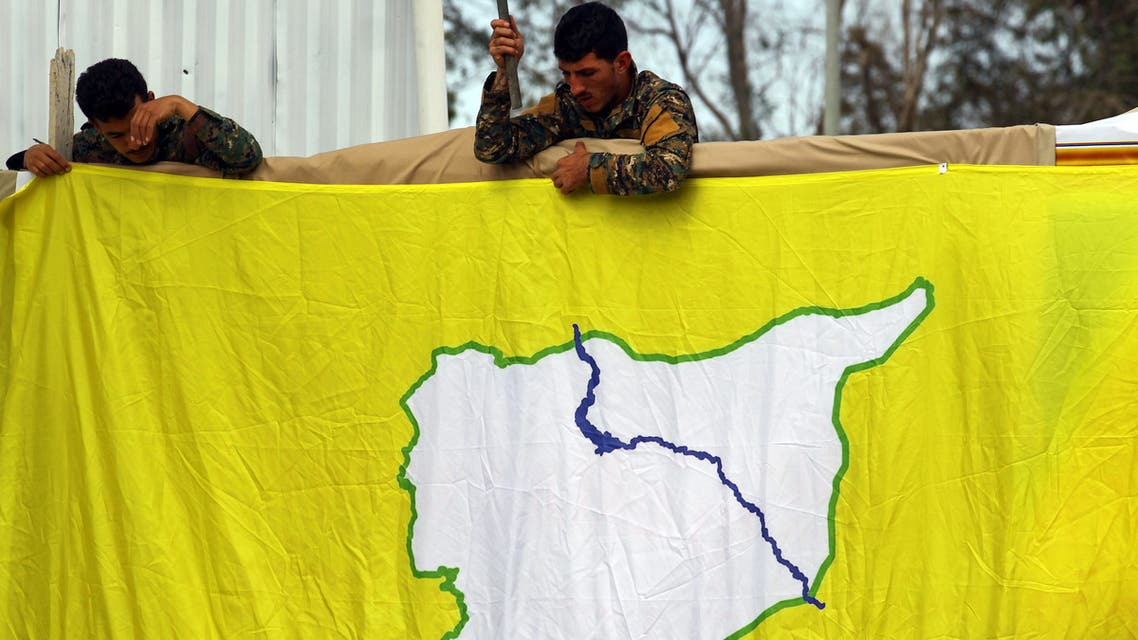 Fighters of Syrian Democratic Forces (SDF) put an SDF flag in al-Omar oil field in Deir Al Zor, Syria March 23, 2019. Picture taken March 23, 2019. REUTERS/Aboud Hamam