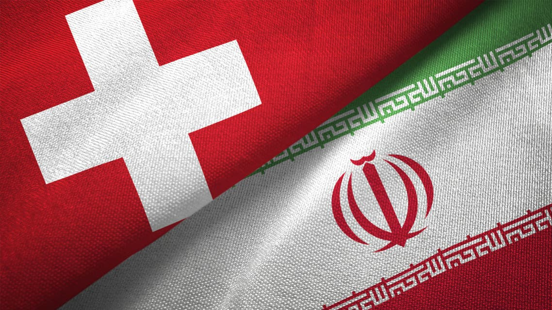 Iran and Switzerland two flags together realations textile cloth fabric texture - Stock image