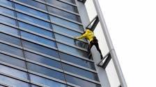 'French Spiderman' climbs Paris skyscraper harness-free