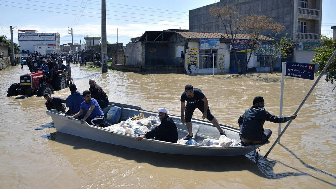 Residents of the northern Iranian village of Agh Ghaleh using a boat in a flooded street. (File photo: AFP)