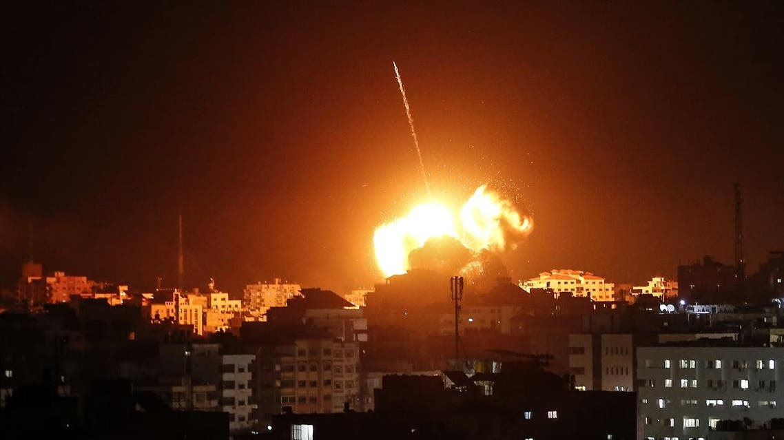 A ball of fire lights the sky above a building believed to house the offices of Hamas chief in Gaza, Ismail Haniyeh, during Israeli strikes on the Gaza City, on March 25, 2019. (AFP)