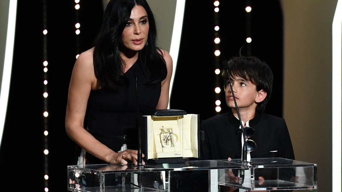 Lebanese director and actress Nadine Labaki (L) delivers a speech on stage next to Syrian actor Zain al-Rafeea after  she was awarded with the Jury Prize for the film Capharnaum on May 19, 2018 during the closing ceremony of the 71st edition of the Cannes Film Festival in Cannes, southern France. Alberto PIZZOLI / AFP