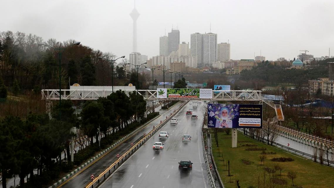 A picture taken on March 26, 2019, shows drivers on a wet road during a rainy day in the Iranian capital Tehran. (AFP)
