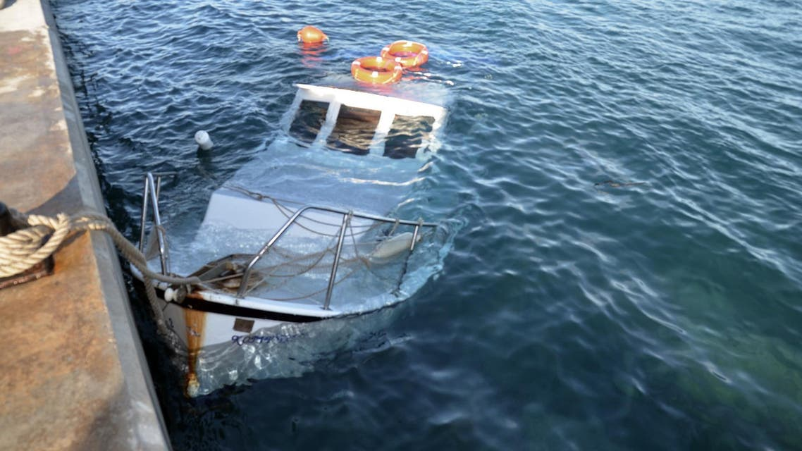 This file photo shows a smuggler's boat, sunk at port in Aegean resort of Didim, Turkey. (AP)