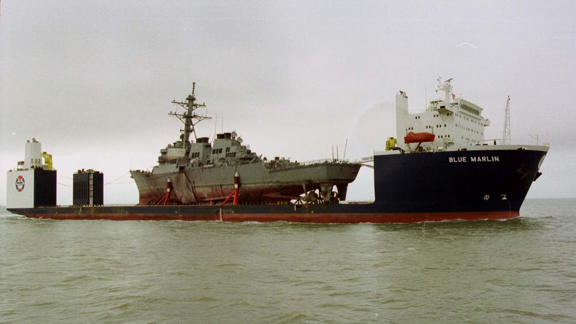 FILE PHOTO: The Norwegian heavy transport ship the Blue Marlin carries the damaged USS Cole through the Mississippi Sound toward the Litton Ingalls Shipbuilding facility in Pascagoula, Mississippi, December 13, 2000. REUTERS/David Rae Morris./File Photo